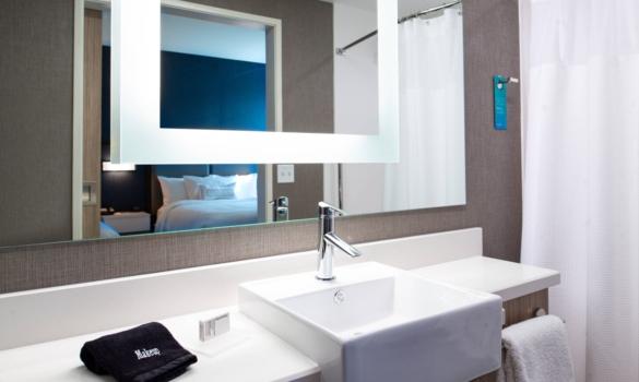 Hotel bathroom vanity top made with white quartz