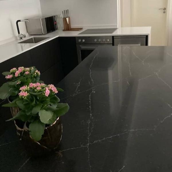 Kitchen island made of black quartz Nero Eclipse