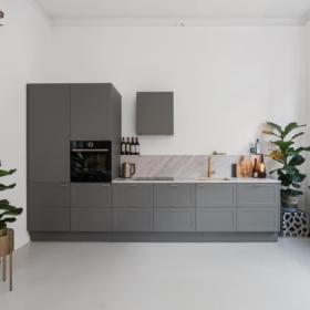 A kitchen countertop made of marble Carrara