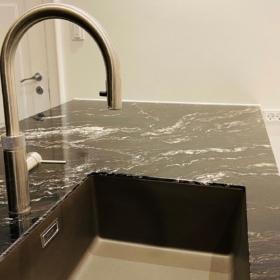 A kitchen countertop made of granite Cosmic Black