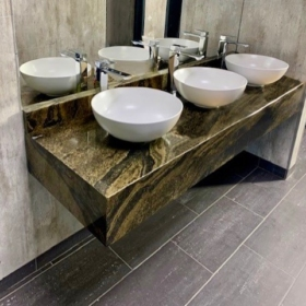 A bathroom vanity top made of granite Maritaca Green