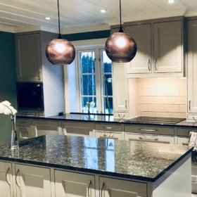A kitchen countertop and kitchen island made of granite Silver Pearl