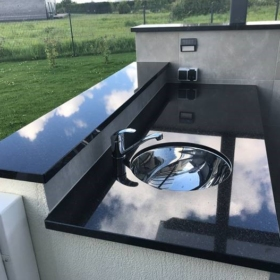An outdoor kitchen countertop made of granite Star Gate